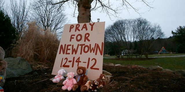 A makeshift memorial in Newtown, Conn., stands in honor of the 20 children and six adults Adam Lanza killed at Sandy Hook Elementary School in 2012.