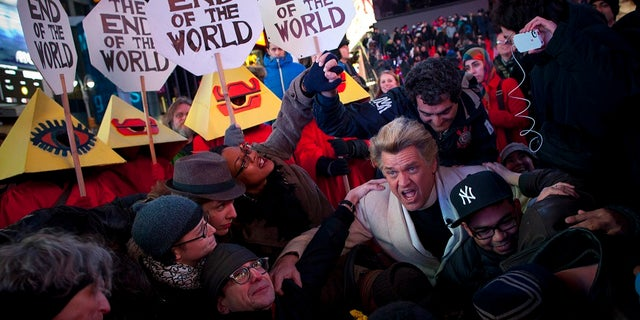 "Reverend Billy, a singer, performs during an ""End of the World"" celebration in New York on December 21, 2012."