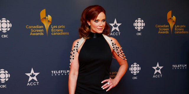 Actress Lauren Holly arrives on the red carpet at the 2014 Canadian Screen awards in Toronto, March 9, 2014. REUTERS/Mark Blinch (CANADA  - Tags: ENTERTAINMENT)   - RTR3GCZO