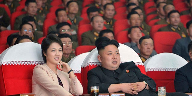 North Korean leader Kim Jong Un and his wife Ri Sol Ju watch a performance by the Moranbong Band in March, 2016. She is known to disappear from the public eye for months at a time.