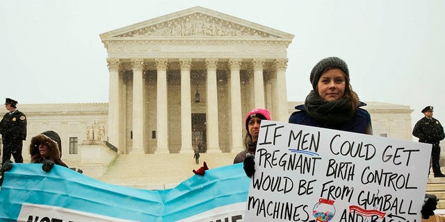 Protesters gathered outside the Supreme Court in 2014 as it began to hear arguments that challenged the ObamaCare mandate that requires employers to cover contraceptive measures through their insurance policies.