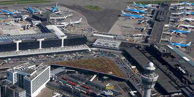 Police at Schiphol airport near Amsterdam shot and arrested a man who allegedly had a knife.