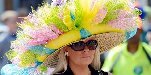 Ashley Cebak wears a derby hat before the 2014 Kentucky Derby at Churchill Downs.