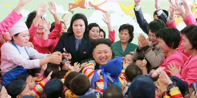 Kim Jong Un poses for a picture with children during a visit to the Pyongyang Baby Home and Orphanage on New Year's Day.