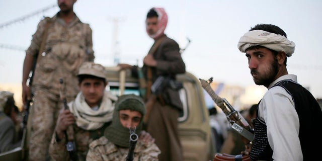 In this January 2015 photo, Houthi fighters patrol a road in Yemen's capital Sana'a. After the group took over the capital in September 2014, a Saudi-led coalition, backed by the U.S., intervened on behalf of the Yemini government.