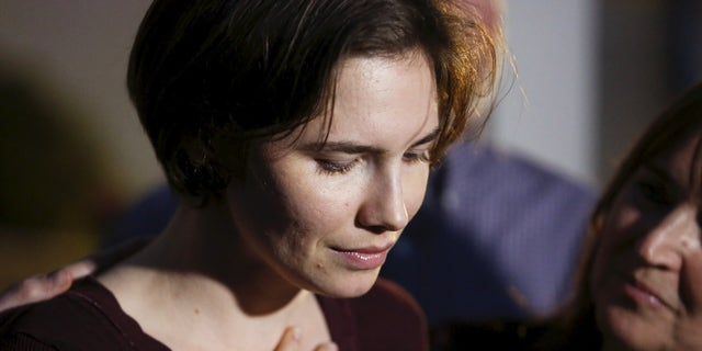 March 27, 2015: Amanda Knox talks to the press surrounded by family outside her mother's home in Seattle, Washington.