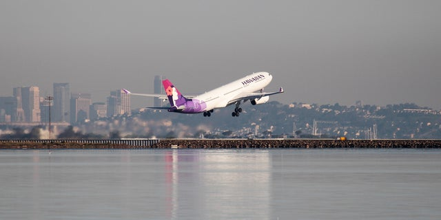 "A file photo of a Hawaiian Airlines flight departing. The airline managed to take passengers ""back in time"" after a flight leaving New Zealand on Monday arrived in Hawaii on Sunday due to the time difference."