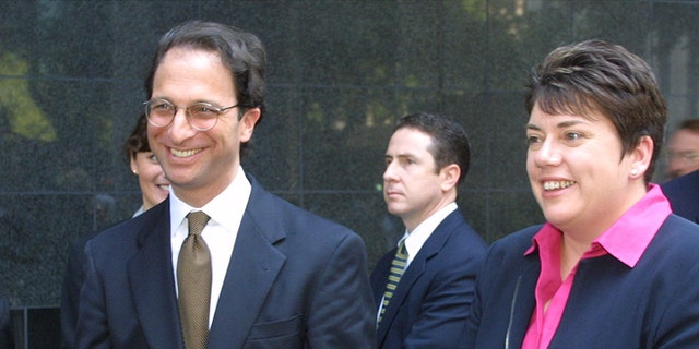 Federal prosecutors Andrew Weissman (L) and Leslie Caldwell smile outside federal court in Houston June 15, 2002 after a jury found the Andersen accounting firm guilty of obstructing justice in an investigation of its client, Enron Corporation