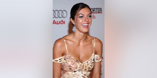 Model Adrianne Curry arrives for The Hollywood Reporter's 75th Anniversary Gala in West Hollywood September 13, 2005. REUTERS/Phil McCarten  PM/KY - RTRNX2S