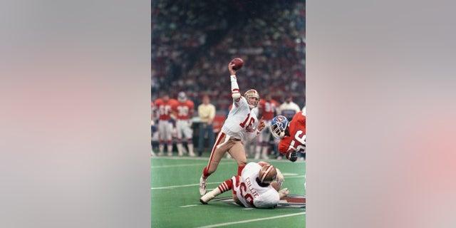 San Francisco quarterback Joe Montana scrambles for yardage during the first quarter of Super Bowl XXIV on January 28, 1990.