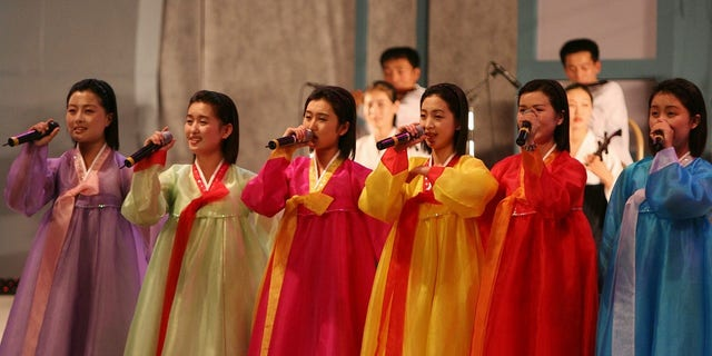 North Korea's cheering squad sings at 2005 Asian Athletics Championships in Incheon, South Korea.