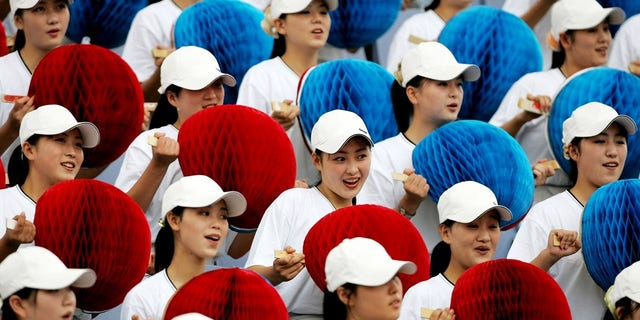 North Korea often sends a brigade of women to sporting events to cheer on the athletes.
