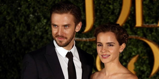 """Dan Stevens and Emma Watson pose for photographers at a media event for the live-action film """"Beauty and the Beast"""" in London, Britain."""