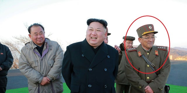 Kim Rak-gyom (circled) is pictured with Kim Jong Un in March 2017. South Korean newspaper Chosun Ilbo said the commander joined Kim in the visit to the military base.