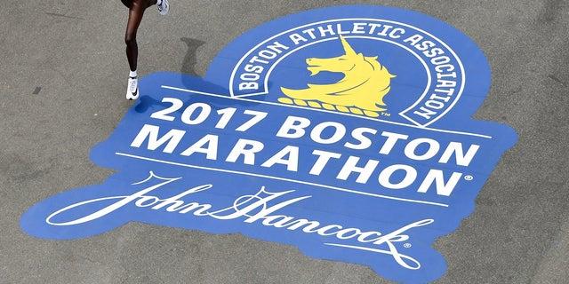 Edna Kiplagat, of Kenya, runs down Boylston Street towards the Boston Marathon finish line. She took first place in the women's division in 2017.