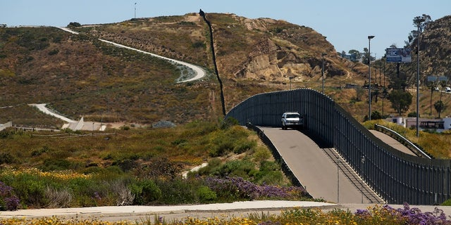 U.S. Border Patrol Agents man the fence between the U.S. and Mexico in San Diego, Calif.
