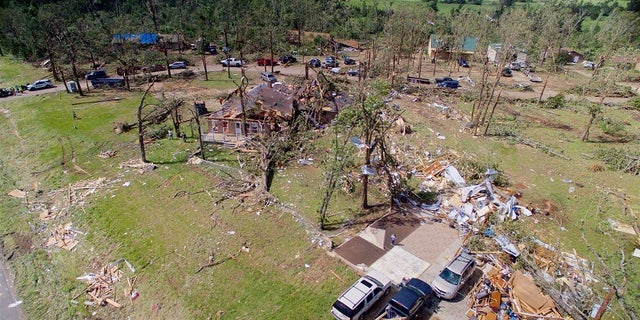 Homes are severely damaged after a tornado hit the town of Emory, Texas, on April 30, 2017.