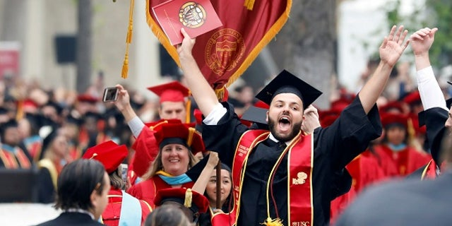 Graduates to be celebrate before the commencement ceremony at the University of Southern California (USC) in Los Angeles, California, U.S., May 12, 2017. REUTERS/Patrick T. Fallon - RTS16FCR