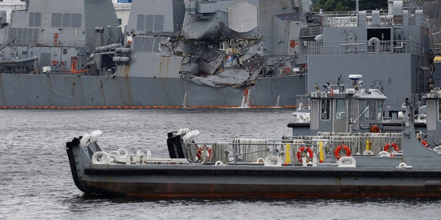The Arleigh Burke-class guided-missile destroyer USS Fitzgerald, damaged by colliding with a Philippine-flagged merchant vessel, is seen at the U.S. naval base in Yokosuka, Japan.