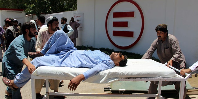 A man is transported to a hospital on a gurney after a car bomb attack in Lashkar Gah, Helmand province, Afghanistan June 22, 2017. REUTERS/Abdul Malik - RTS1869X