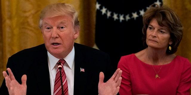 President Trump with Alaska Sen. Lisa Murkowski in June. Fellow Alaska Sen. Dan Sullivan said he and Murkowski told Trump not to rename Denali.