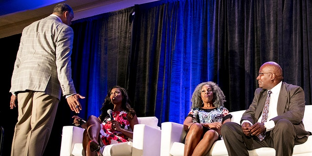 (L-R) Panel moderator Edward Gordon, White House aide Omarosa Manigault, Cheryl Dorsey and Arthur Reed react during a panel discussion at the National Association of Black Journalists convention in New Orleans, Louisiana, U.S. August 11, 2017.  REUTERS/Omar Negrin - RTS1BFSO