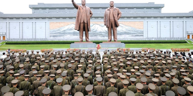 Kim Il Sung did not live long enough to see his country's first successful nuclear weapons test. In this photo, members of the Korean People's Army and the Korean People's International Security Forces stand in front of a statue of Kim Il Sung and Kim Jong Il on the 72nd anniversary of national liberation.