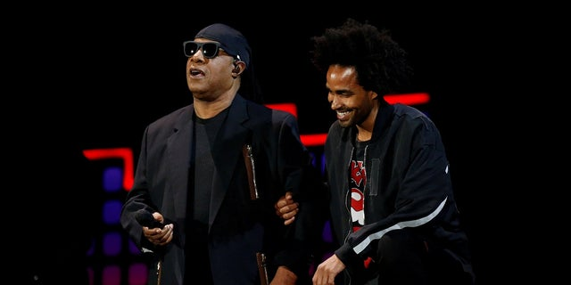 Singer Stevie Wonder takes two knees with the help of his son Kwame Wonder before performing at the 2017 Global Citizens Festival at Central Park.