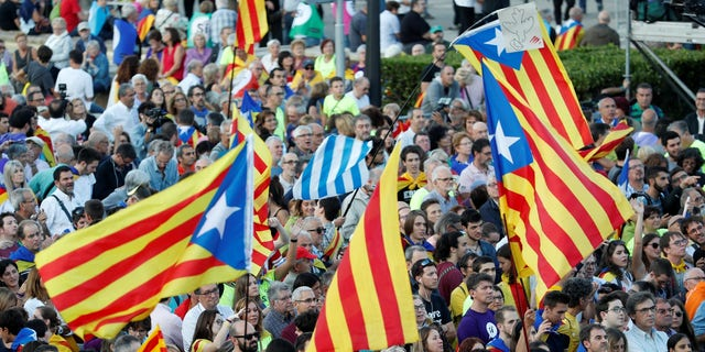 People hold Esteladas (Catalan separatist flags) as they wait for a closing rally in favour of the banned October 1 independence referendum in Barcelona, Spain September 29, 2017.