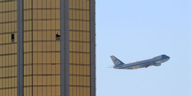 Air Force One departs Las Vegas past the broken windows on the Mandalay Bay hotel, where shooter Stephen Paddock conducted his mass shooting along the Las Vegas Strip in Las Vegas, Nevada.
