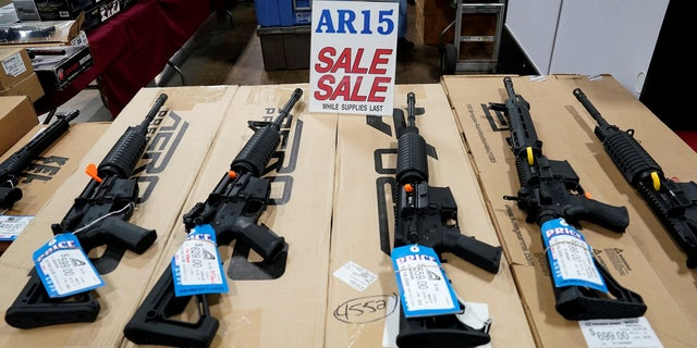 AR-15 rifles are displayed for sale at the Guntoberfest gun show in Oaks, Pa.
