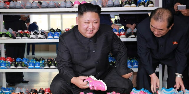 Kim Jong Un looks at children's shoes during his visit to Ryuwon Footwear Factory. Kim has been threatening the U.S. mainland.