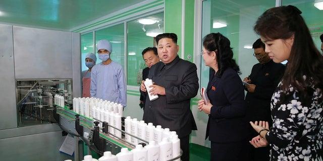 Kim Jong Un and wife Ri Sol Ju visit a cosmetics factory in October 2017.