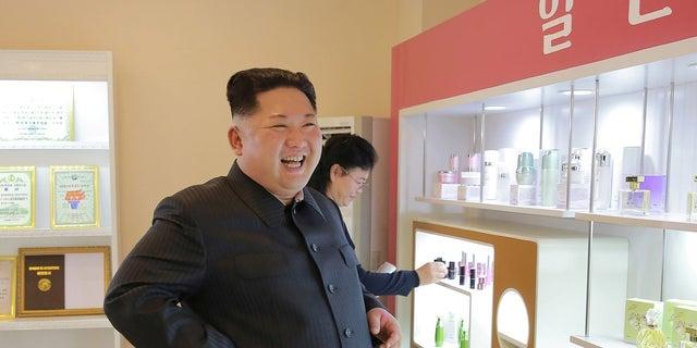 Kim Jong Un and wife Ri Sol Ju visit a cosmetics factory.