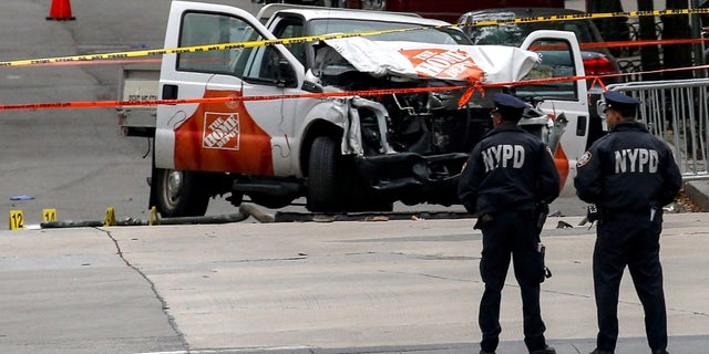 Police investigate a pickup truck used in an attack on the West Side Highway in lower Manhattan in New York City, U.S., November 1, 2017.