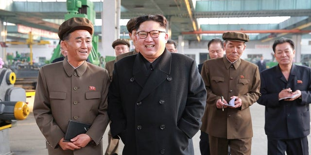 Kim Jong Un visits a factory in this undated picture provided by KCNA in Pyongyang.