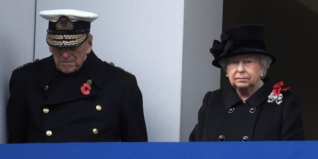 Queen Elizabeth II and Prince Philip, Duke of Edinburgh stand in silence at the Remembrance Sunday Cenotaph service in London, Britain, November 12, 2017.