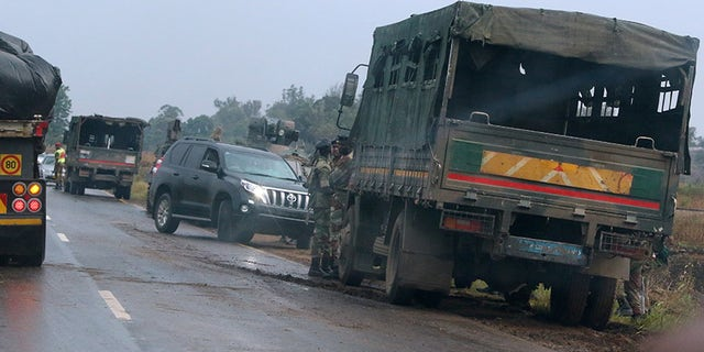 Military vehicles fill the streets outside Harare, Zimbabwe.