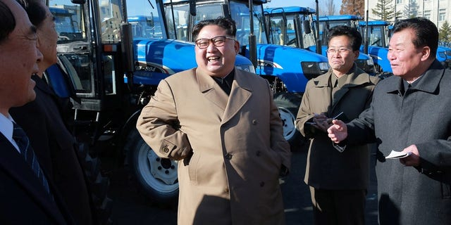 North Korean leader Kim Jong Un gives field guidance to the Kumsong Tractor Factory.