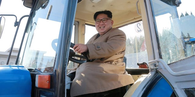Kim is pictured in a tractor during a field guidance visit.