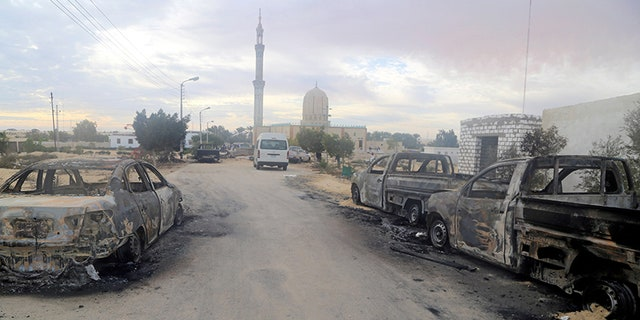 Damaged vehicles are seen after a bomb exploded at Al Rawdah mosque in Bir Al-Abed, Egypt