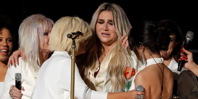 The performance ended with a group up and many of the singers, including Kesha, in tears.