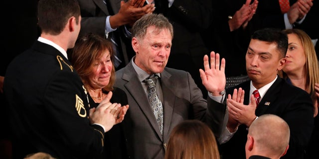 Fred and Cindy Warmbier cry as U.S. President Donald Trump talks about the death of their son Otto after his arrest in North Korea during the State of the Union address to a joint session of the U.S. Congress on Capitol Hill.