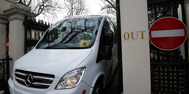 A bus carrying 23 expelled diplomats and their families leaves the Russian embassy in London.