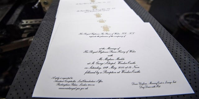 The wedding invitation was designed by Barnard & Westwood.