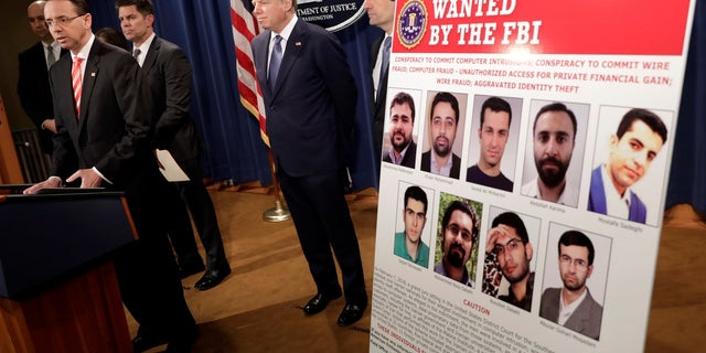 U.S. Deputy Attorney General Rod Rosenstein speaks at a news conference with other law enforcement officials at the Justice Department to announce nine Iranians charged with conducting massive cyber theft campaign, in Washington, U.S., March 23, 2018.