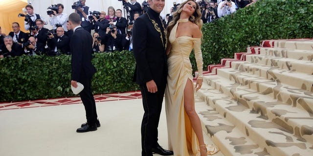 Tom Brady and Gisele Bundchen wore Versace to the Met Gala.