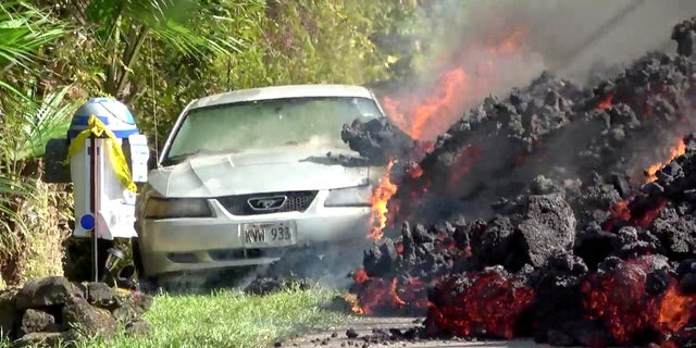 Lava engulfs a Ford Mustang in Puna, Hawaii, over the weekend.