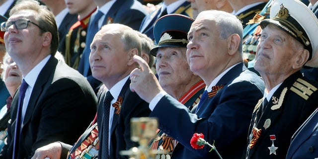 Putin and Netanyahu watch the Victory Day parade.