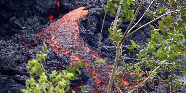 In this May 12, 2018 photo, lava erupts from a fissure during ongoing eruptions of the Kilauea Volcano in Hawaii.